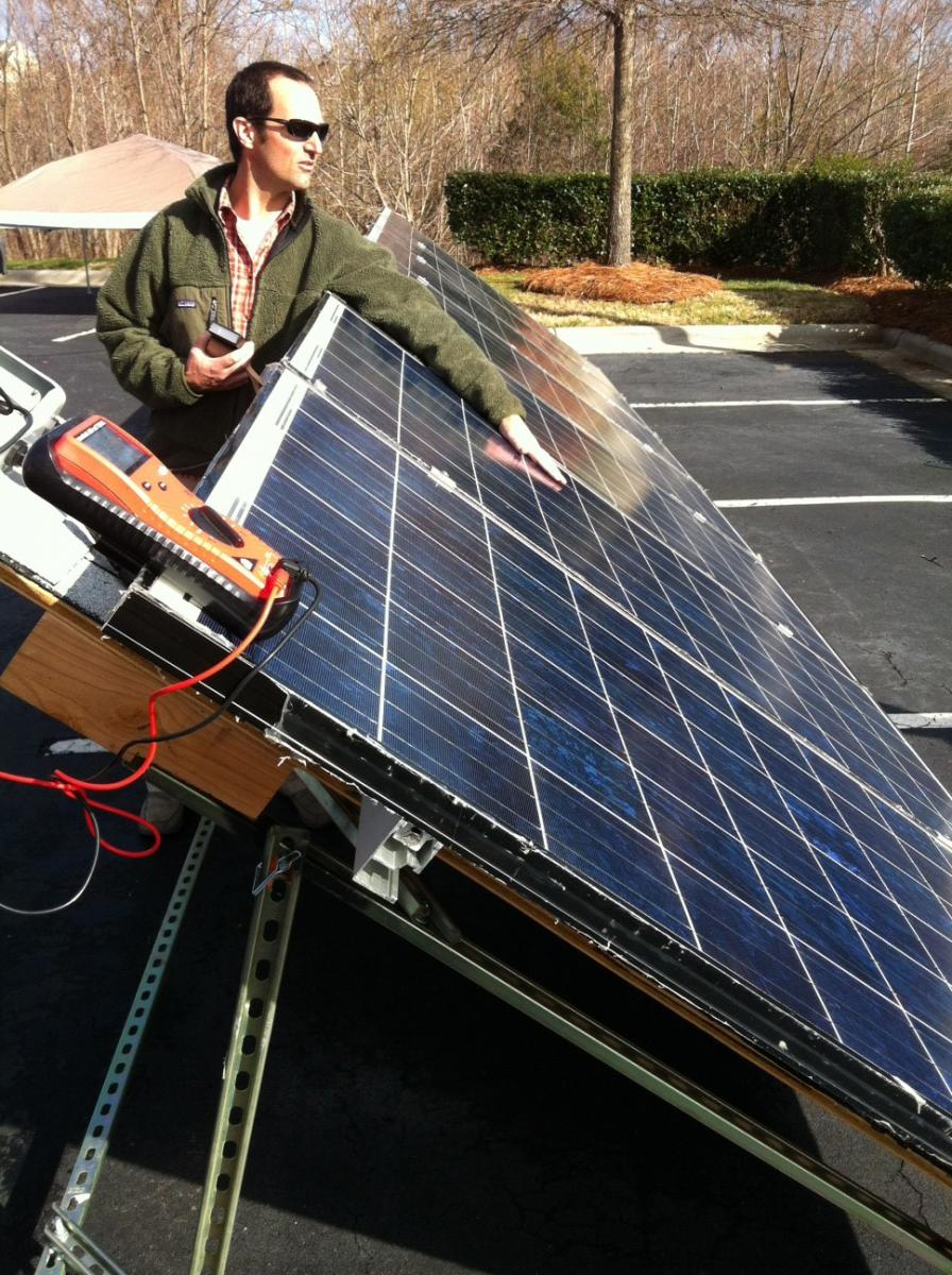 Everblue instructor demonstrates a completed solar array during the Solar PV Installer training course.