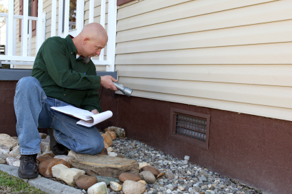 Energy Auditor conducting exterior inspection